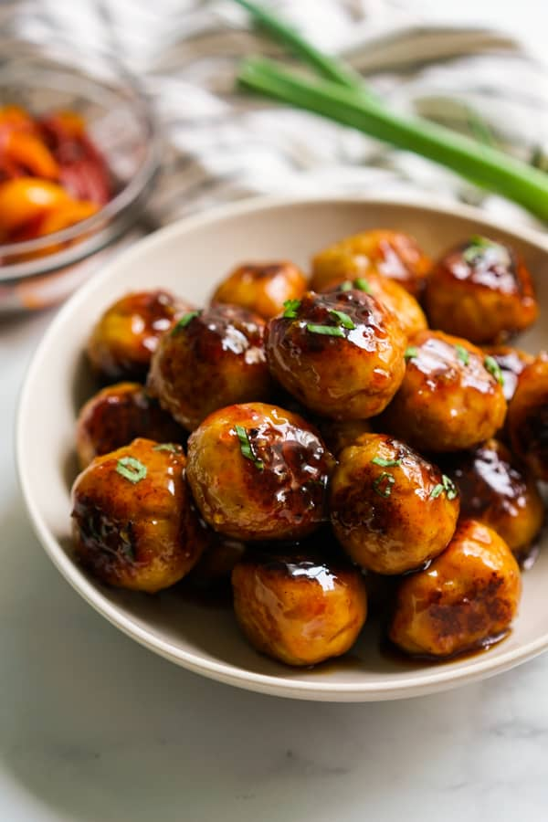 A bowl of sweet and sour chicken meatballs