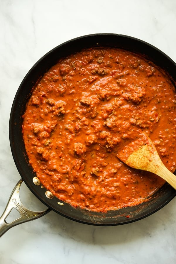 Creamy tomato sauce with Italian sausage in a large round skillet
