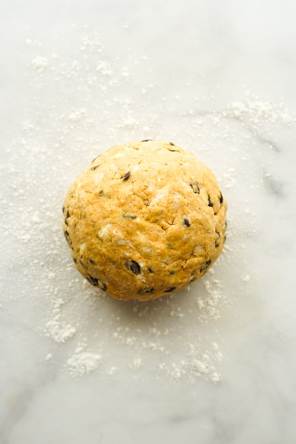 Rolled scones dough into a ball on floured surface