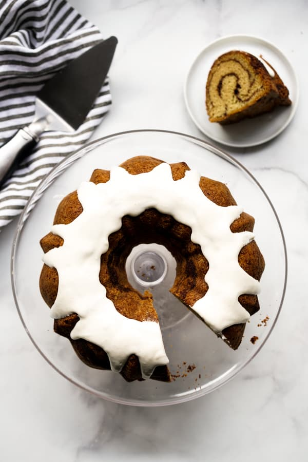 Top down view of a cut out bundt cake with the cut out slice on a separate plate