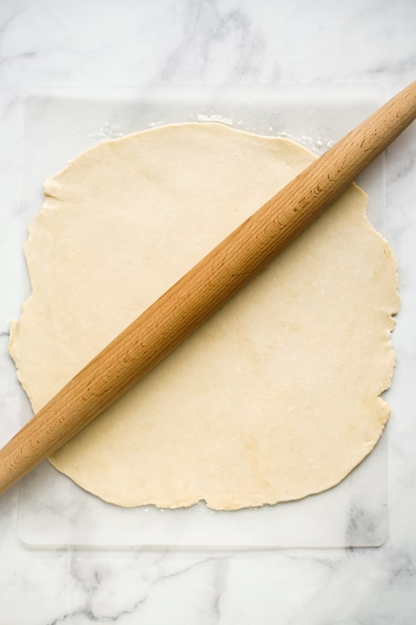 Rolling pie crust with rolling pin
