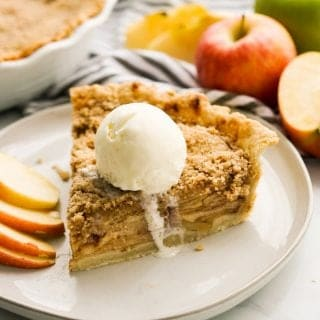 Apple crumble pie topped with vanilla ice cream