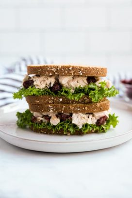 Two pieces of turkey salad sandwiches stacked on top of each other