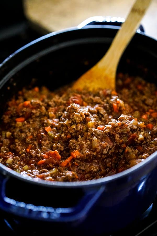 Cooking bolognese meat sauce on the stovetop