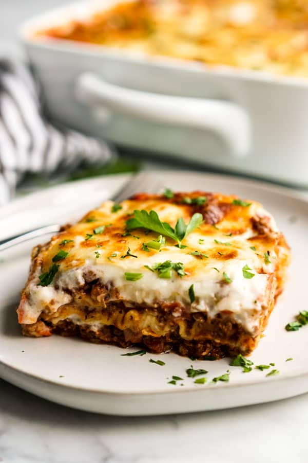 A slice of lasagna on a plate