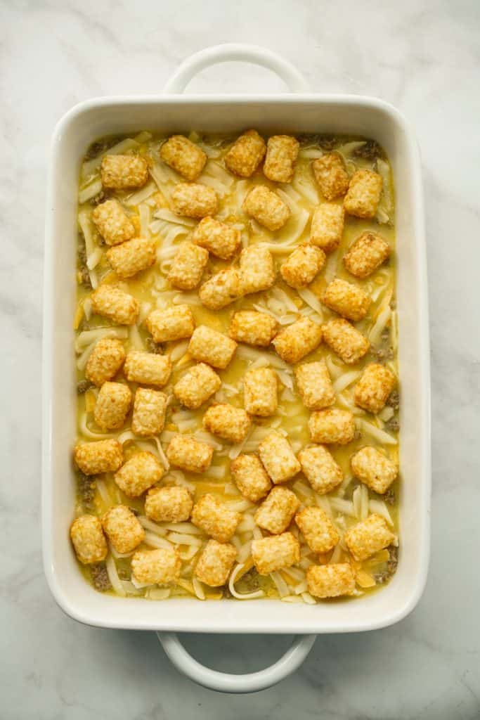 Sausage, eggs and cheese in a casserole with tater tots on top