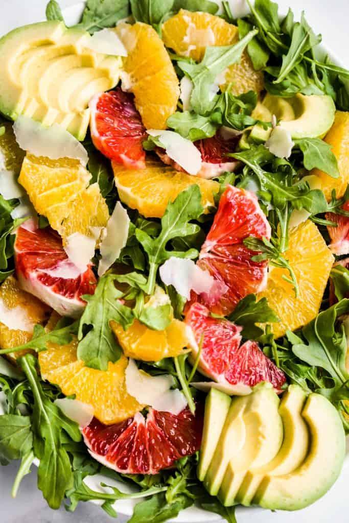 Closeup of Avocado Orange Salad with arugula