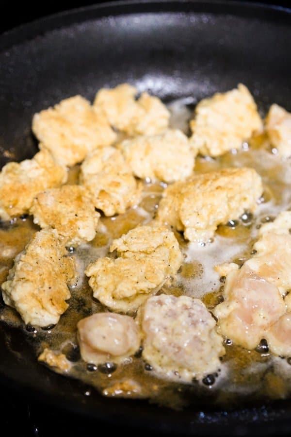 Pan frying crispy chicken in oil