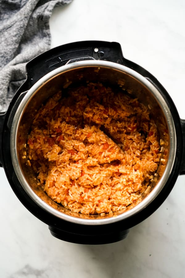 Top down view of seasoned rice in Instant Pot