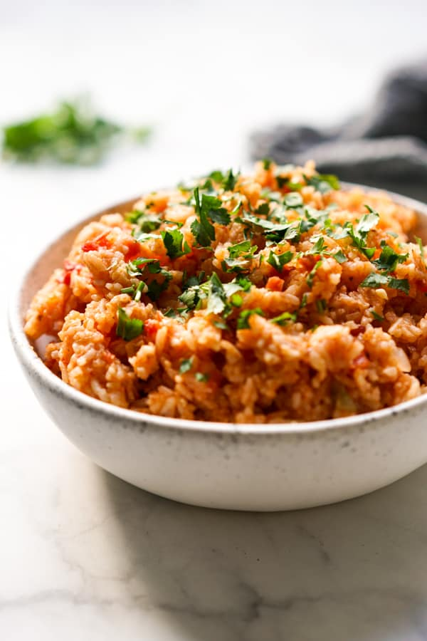 A bowl of Mexican rice topped with cilantro