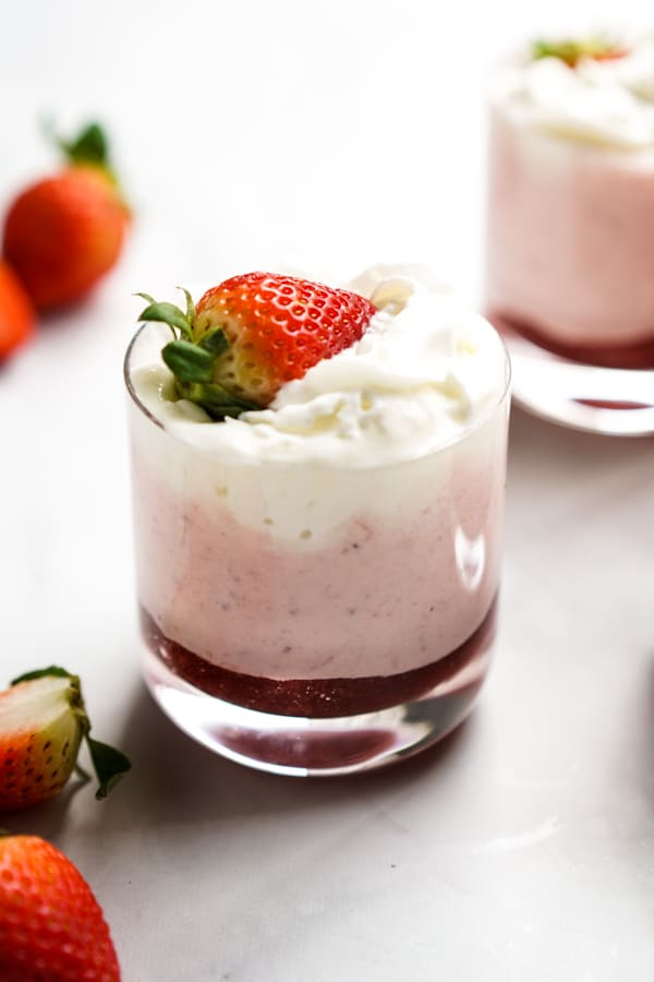 Strawberry mousse with whipped cream on top