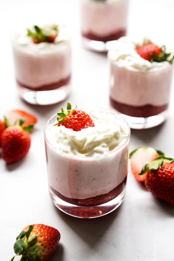 Four small glasses of strawberry mousse