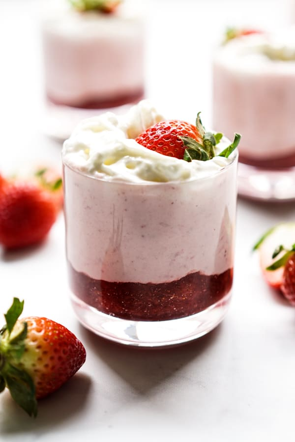 Layers of strawberry sauce, strawberry mousse, whipped cream and fresh strawberries.