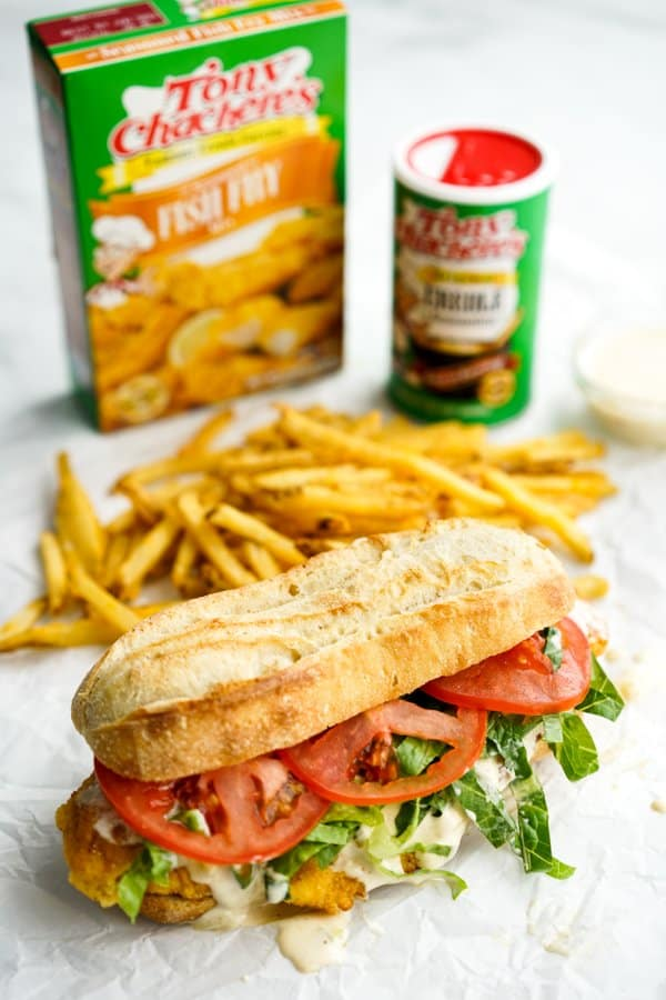 Fish Po' Boy sandwich with fries, Tony Chachere's seasonings in the background