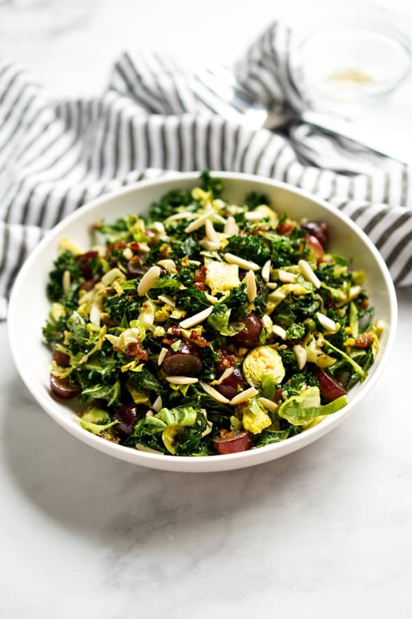 A bowl of tossed brussels sprouts and kale