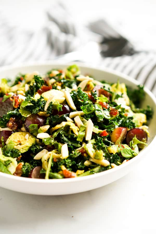 A bowl of Brussels Sprouts kale and grapes tossed together