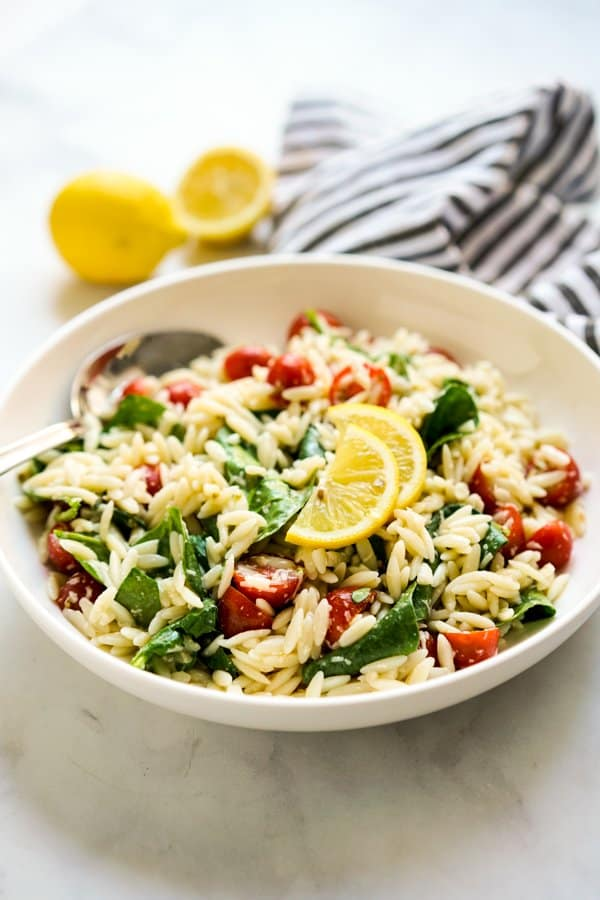 A bowl of Lemon Orzo Spinach Cherry Tomato Salad