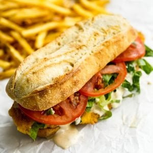 Fish Po Boy Sandwich with fries in the background