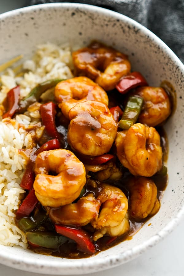 Closeup of Shrimp Stir fry with bell peppers tossed in sticky sauce