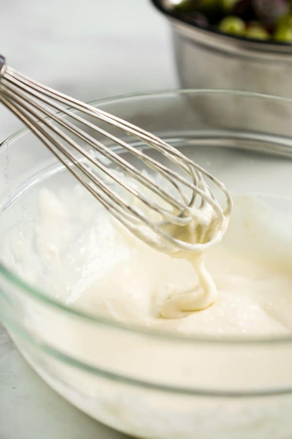 Whisking cream cheese and sour cream dressing