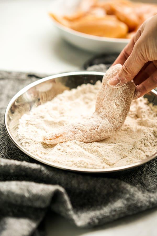 Coat chicken tenders in flour mixture