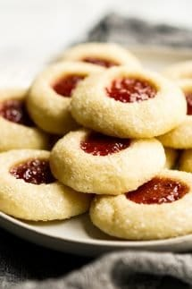 A plate of Strawberry Shortbread Thumbprint Cookies