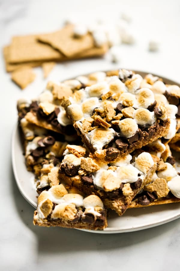 A plate of S'mores Bars stacked on top of each other