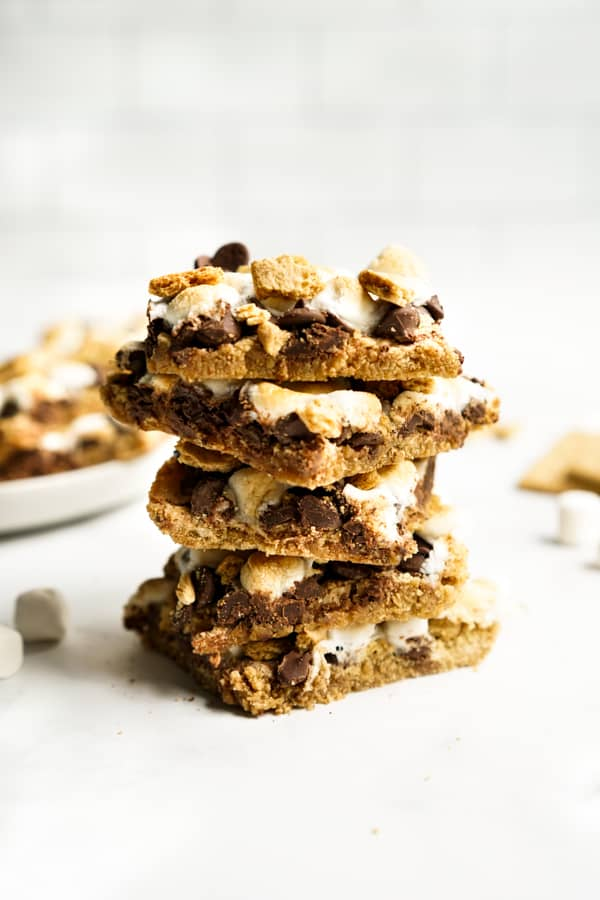 a stack of S'mores Bars with chocolate, graham crackers and marshmallow