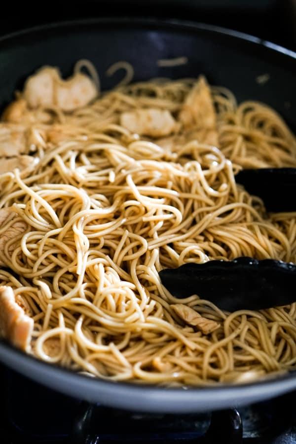 Stir frying noodles in a skillet