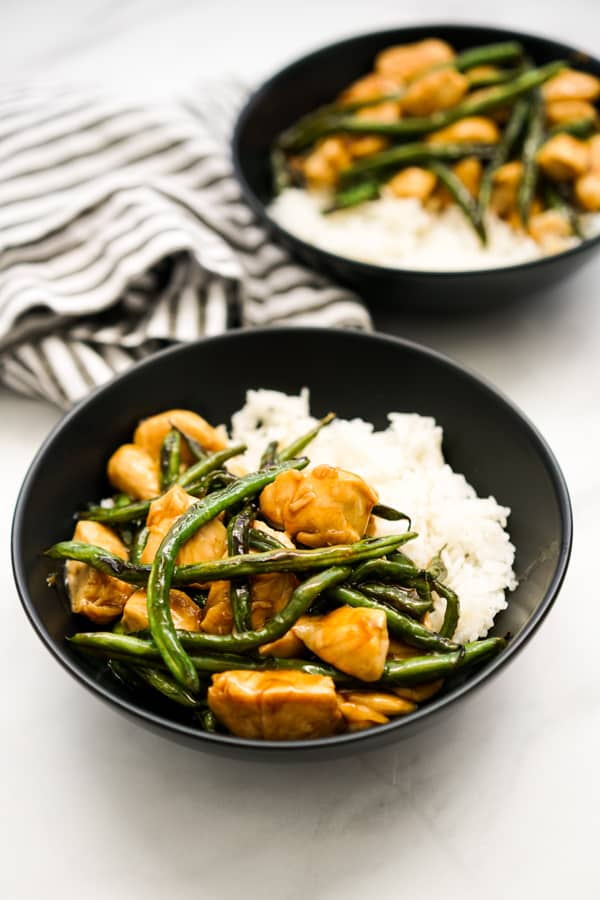 Two bowls of Chicken Teriyaki Stir Fry on top of white rice