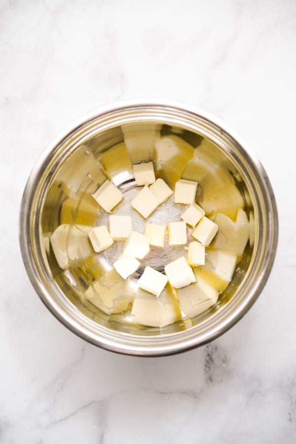 Cold cubed butter in a bowl