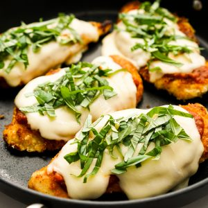 Breaded chicken topped with red sauce and melted cheese