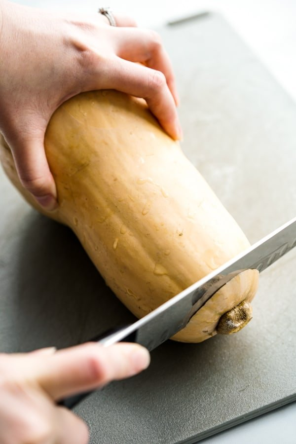 Cutting off the top of a butternut squash