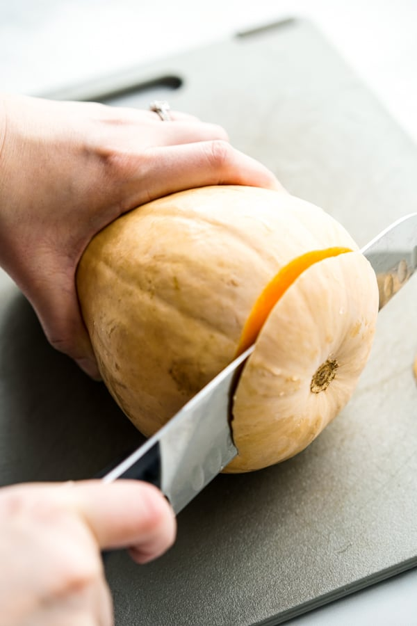 Cutting of the bottom of a butternut squash