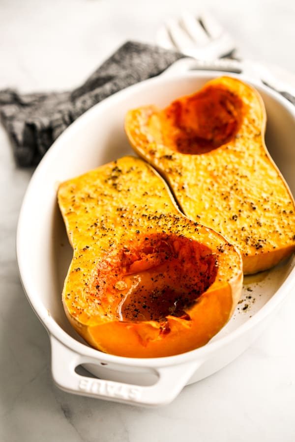 A oval bowl of two Whole Roasted Butternut Squash