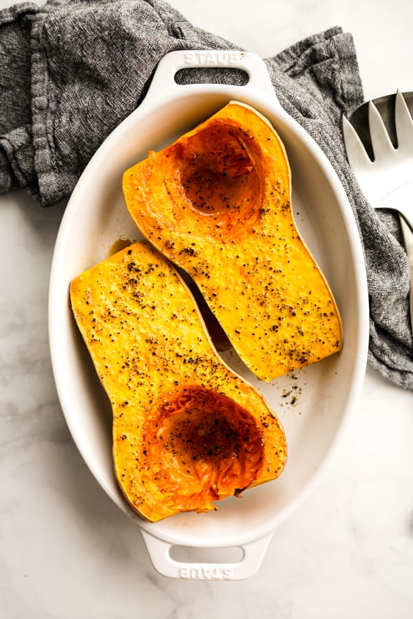 Top down view of two halves of a whole oven baked butternut squash
