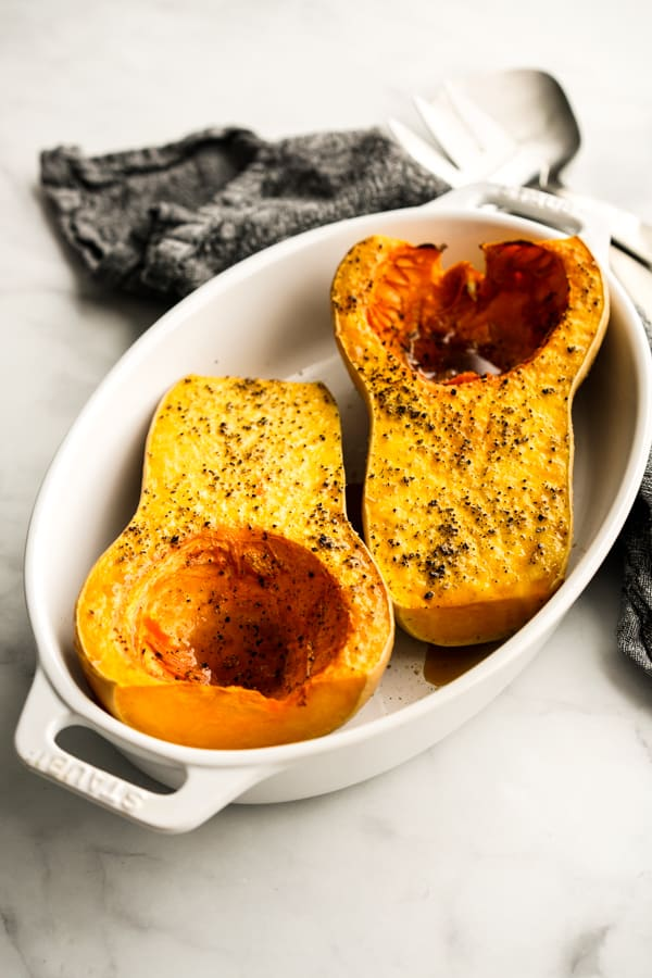 Whole butternut squash cut into half and roasted