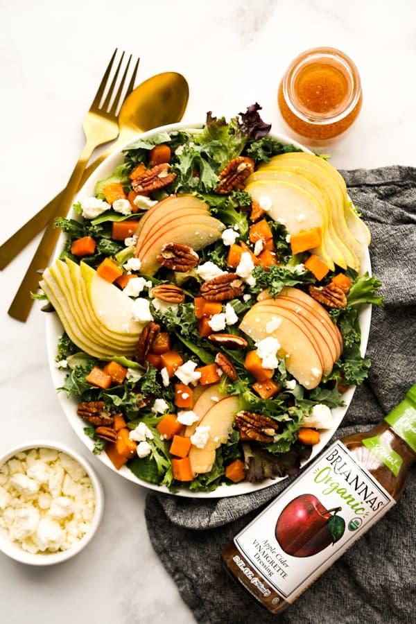 Fall Harvest Salad with bottle of vinaigrette on the side